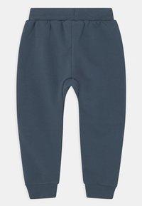 Lindex - KNEE DETAIL UNISEX - Trousers - dusty blue - 1