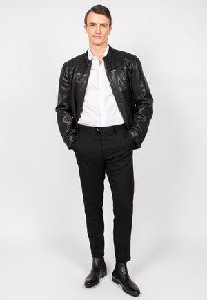 LANDEN - Leather jacket - black