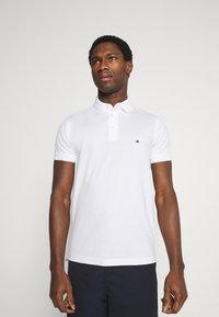 Tommy Hilfiger - Polo shirt - white - 0