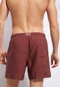 Calzedonia - Swimming shorts - cinnamon red - 1