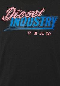 Diesel - T-DIEGOS-K37 UNISEX - Print T-shirt - black - 2