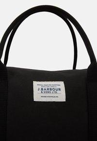 Barbour - EADAN HOLDALL UNISEX - Weekend bag - black - 4