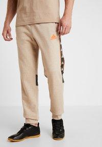 adidas Performance - Pantalones deportivos - tan - 0