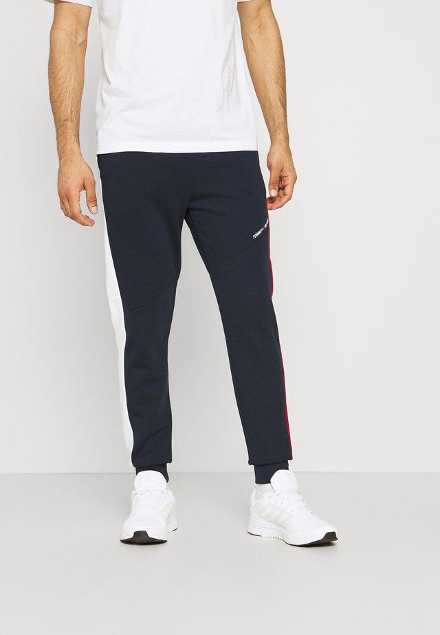 BLOCKED TERRY PANT - Pantalon de survêtement - blue