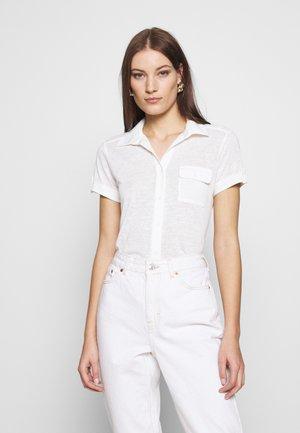 SHORT SLEEVE - Button-down blouse - cream