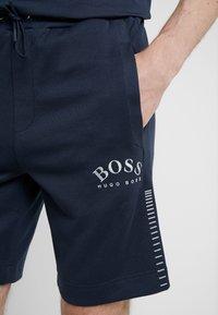 BOSS - HEADLO WIN - Pantalon de survêtement - blue/silver - 5