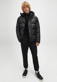 Calvin Klein Jeans - Winter jacket - ck black - 1