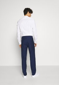 Tommy Hilfiger Tailored - MACRO SLIM FIT SEPARATE - Trousers - blue - 2