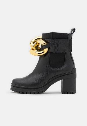 WHAT`S NEXT - Platform ankle boots - black