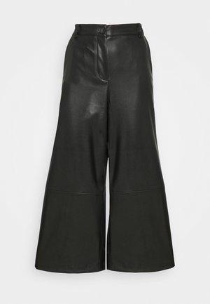 MILLI - Trousers - black