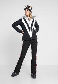 Luhta - JARVALA - Spodnie narciarskie - black - 1