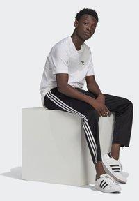 adidas Originals - ADICOLOR CLASSICS FIREBIRD PRIMEBLUE TRACK PANTS - Tracksuit bottoms - black - 4