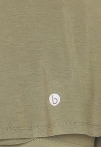 Cotton On Body - DOUBLE LAYER PETAL HEM SHORT - Sports shorts - oregano - 5