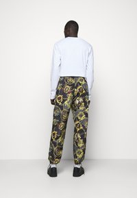 Versace Jeans Couture - MAN TROUSER - Tracksuit bottoms - nero - 2
