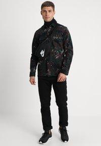 Nike Sportswear - HERITAGE UNISEX - Sac banane - black/white - 0