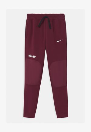 AIR - Tracksuit bottoms - dark beetroot