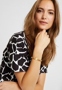 Guess - CHAIN REACTION - Bracelet - gold-coloured - 1