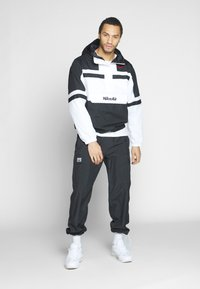 Nike Sportswear - M NSW NIKE AIR JKT WVN - Wiatrówka - white/black - 1