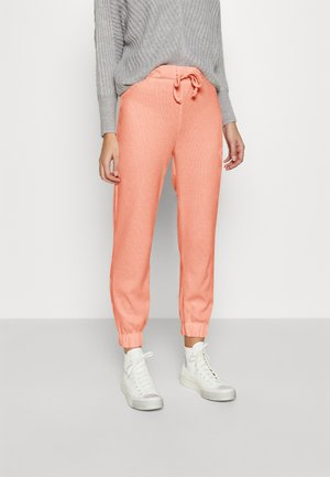 LOUNGE JOGGER - Tracksuit bottoms - pink