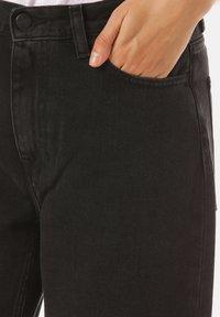 Carhartt WIP - Flared Jeans - black - 4