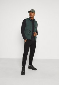 Diesel - PETER TROUSERS - Tracksuit bottoms - black - 1