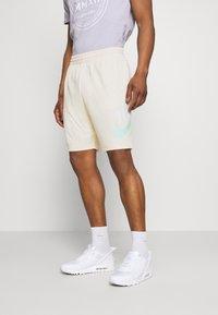 Nike SB - SUNDAY UNISEX - Tracksuit bottoms - coconut milk/light dew - 0