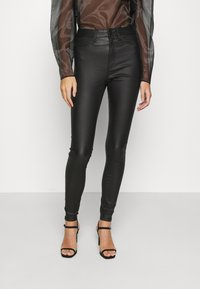 Noisy May - NMCALLIE SKINNY COATED PANTS - Jeans Skinny Fit - black - 0