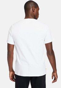Timberland - Print T-shirt - white - 2