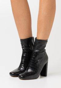 Call it Spring - SERENN - Ankelboots med høye hæler - black - 0