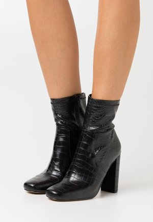 SERENN - Bottines à talons hauts - black