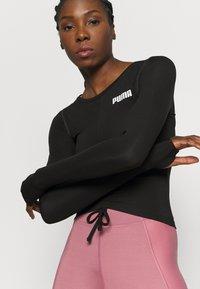 Puma - PAMELA REIF X PUMA COLLECTION RUSHING - Camiseta de deporte - puma black - 3