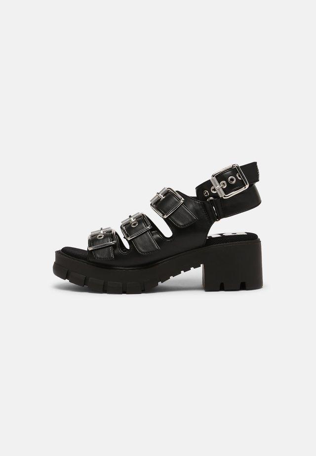 VEGAN RAJA - Sandalen met plateauzool - black
