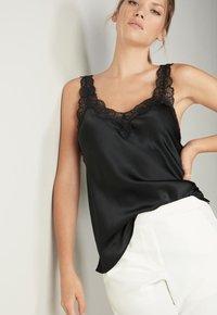 Intimissimi - Pyjama top - nero - 0