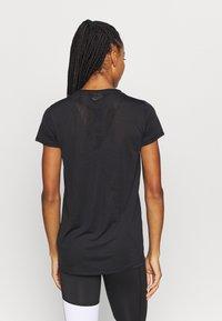 Puma - STUDIO KEYHOLE TEE - Basic T-shirt - black - 2