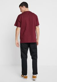 Carhartt WIP - ABBOTT PANT DENISON - Broek - black rinsed - 2