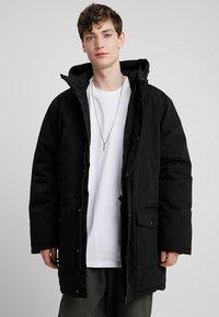 Carhartt WIP - TROPPER - Winter coat - black - 0