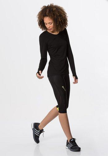DNAMIC - 3/4 sportovní kalhoty - black/limoncello