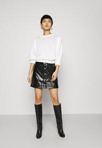 Calvin Klein Jeans - HIGH SHINE MINI SKIRT - A-line skirt - black - 1