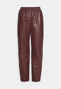 Marimekko - IHMETELLÄ TROUSERS - Leather trousers - wine red - 3