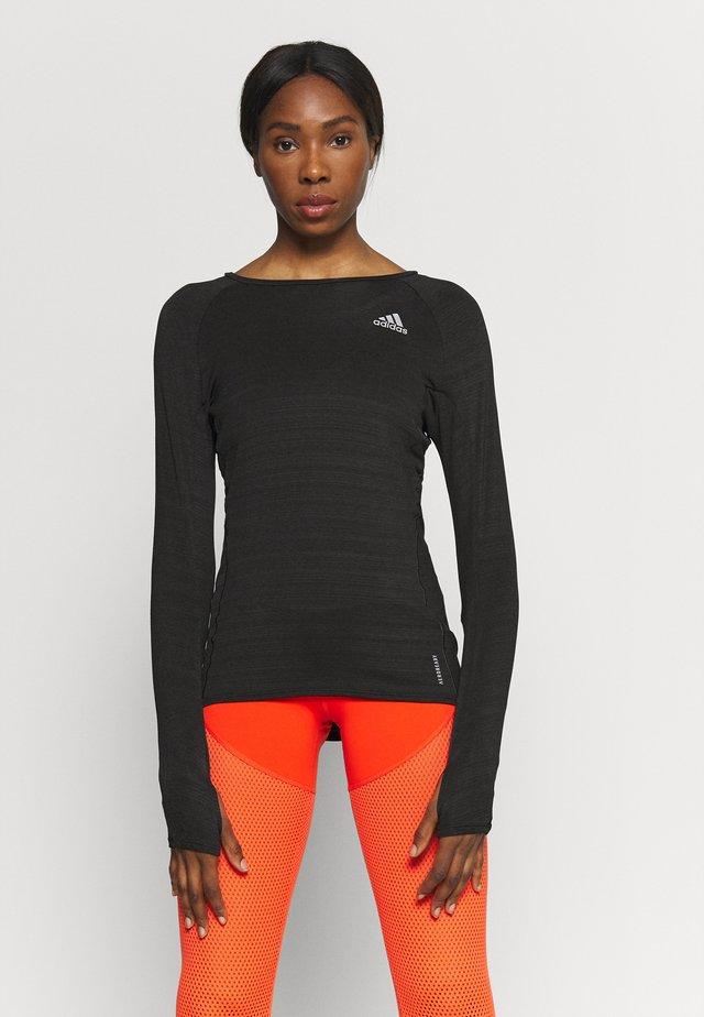 ADI RUNNER - T-shirt sportiva - black/reflective silver