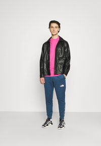 The North Face - PANT - Tracksuit bottoms - monterey blue - 1