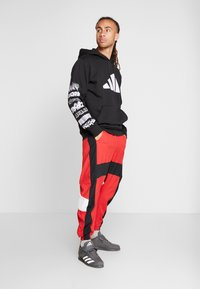 adidas Performance - SHAPE PANT - Tracksuit bottoms - scarlet - 1