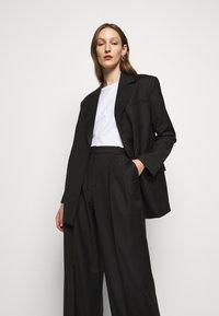 House of Dagmar - CHARLOTTE  - Short coat - black - 0