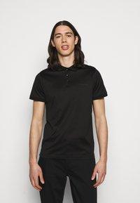 KARL LAGERFELD - PRESS BUTTON - Polo shirt - black - 0