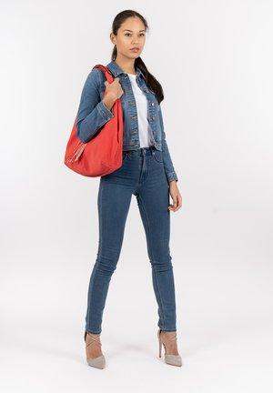 MELLY - Handbag - red