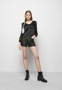 maje - LIFFANY - Long sleeved top - noir - 1