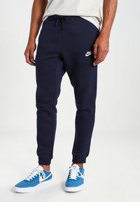 Nike Sportswear - CLUB JOGGER - Tracksuit bottoms - blue - 0