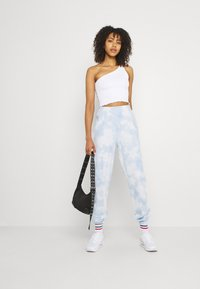 Gina Tricot - JACKIE - Tracksuit bottoms - blue - 1
