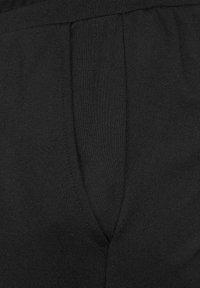 Cecil - LOOSE FIT - Tracksuit bottoms - schwarz - 4