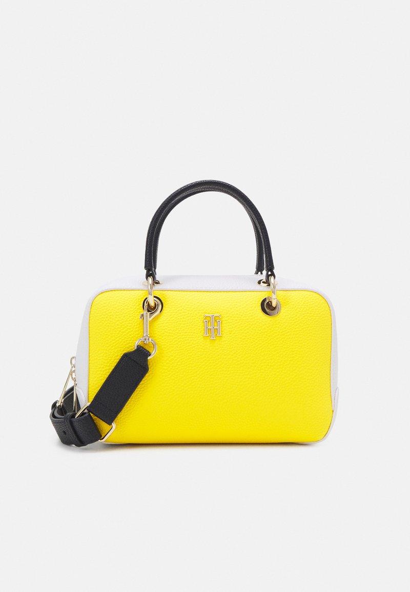 Tommy Hilfiger - ESSENCE DUFFLE - Handbag - yellow